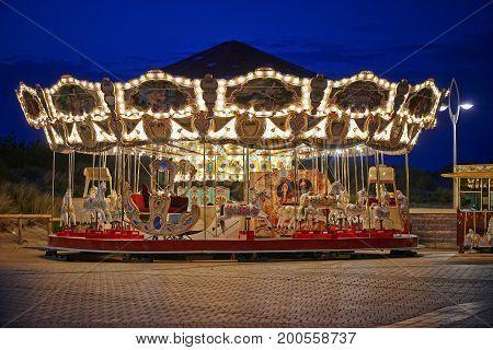 Merry-go-round On Belgian Seaside By Night
