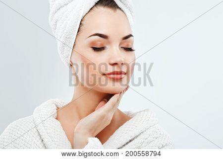 Cute Girl Wearing Rowel And Bathrobe At Gray Studio Background
