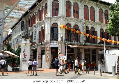 Bustling Street Of Chinatown District In Singapore