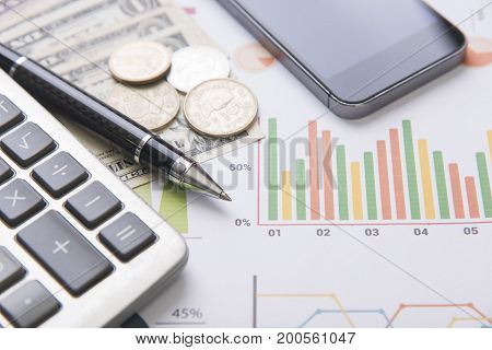 pen calculator money graph concept for business finance.