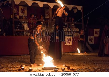 Alburquerque Spain - august 19 2017. Female fire show performer at night participing in festival medieval in Alburquerque