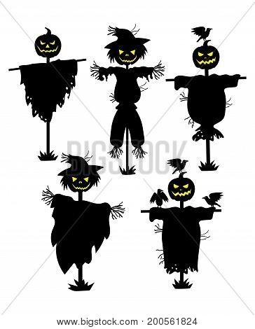 A set of silhouettes of scarecrows. Collection of black silhouettes stuffed with pumpkin head. Set for Halloween.
