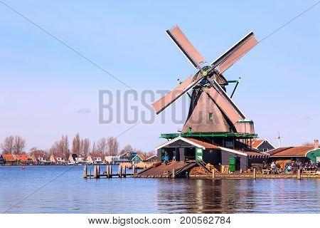Zaanse schans, Netherlands - April 1, 2016: Windmills in Zaanse Schans, North Holland, traditional village and tourists
