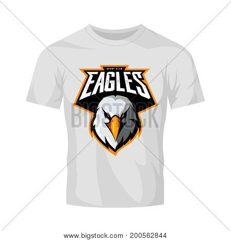 Furious eagle head athletic club vector logo concept isolated on white t-shirt mockup.  Modern sport team mascot badge design. Premium quality wild bird emblem t-shirt tee print illustration.
