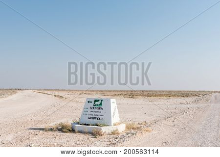 ETOSHA NATIONAL PARK NAMIBIA - JUNE 26 2017: A distance sign on the road between the Okaukeujo and Olifantsrus Rest Camps in the Etosha National Park