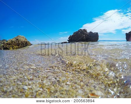 Pebbles and rocks on the foreshore in Sardinia Italy