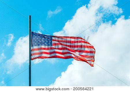 Waving Colorful American Usa Flag On Blue Sky