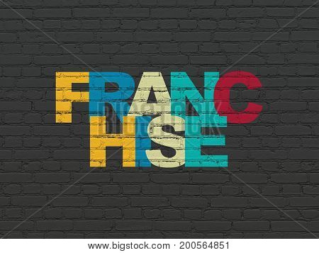 Business concept: Painted multicolor text Franchise on Black Brick wall background