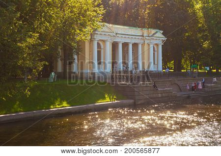 ST PETERSBURG RUSSIA - AUGUST 15 2017. Rossi Pavilion in the Michael Garden and the Moika river in St Petersburg Russia. City landscape in sunny day in St Petersburg Russia