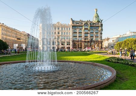 ST PETERSBURG RUSSIA-AUGUST 15 2017. Zinger House on Nevsky Prospect in the historic center of the St Petersburg  and fountain on the foreground. Summer evening in St Petersburg center Russia