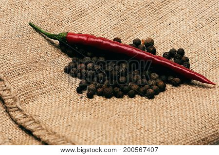 Chili Pepper With Black Pepper On Sackcloth Napkin
