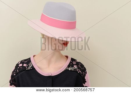 Woman in clothing with hat