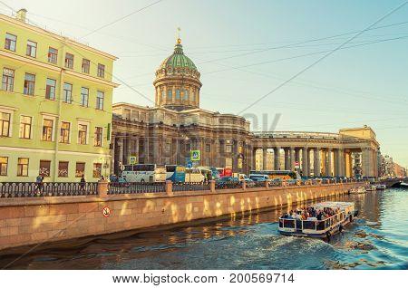ST PETERSBURG RUSSIA - AUGUST 15 2017. Kazan cathedral and Griboedov channel in St Petersburg Russia. Architecture landscape of St Petersburg landmark in sunny weather