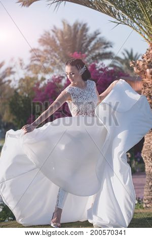 Woman Bride With In Beautiful White Wedding Dress And Trousers