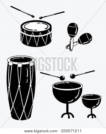 A set of percussion musical instruments. Collection of musical drums. Stylized musical instruments. Black and white vector illustration.