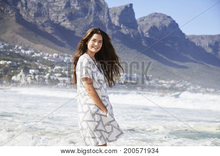 Beautiful brunette beach babe in summer dress portrait