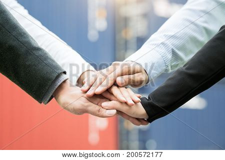 Team work concept. Business people joining hands in Warehouse shipping transportation concept.