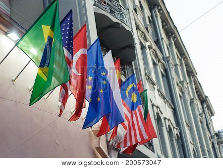 National flags of Brazil the USA Turkey the European Union Russia China and Malaysia on the wall of the building