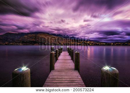 Sunset With A Dock In Lake Wakatipu