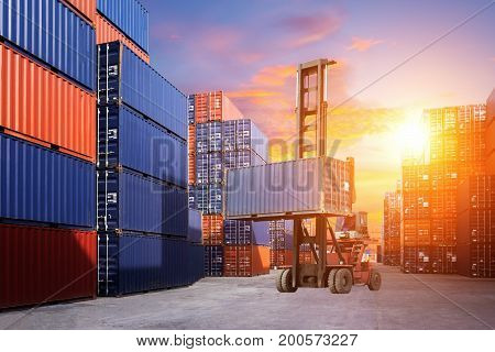 Forklift handling container box loading to freight train in import and export