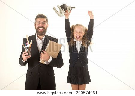 Father And Schoolgirl With Happy Faces Isolated On White