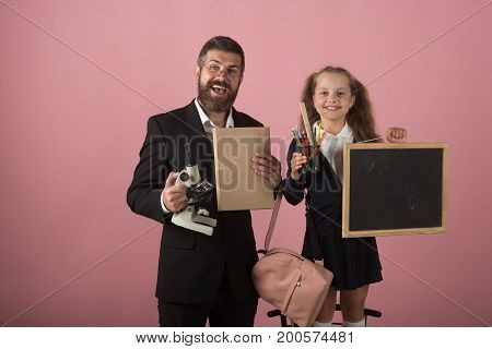 Father And Schoolgirl With Happy Faces On Pink Background