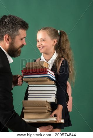Education And Back To School Concept. Kid Gives Books
