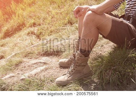 The guy in trekking beige boots. close-up