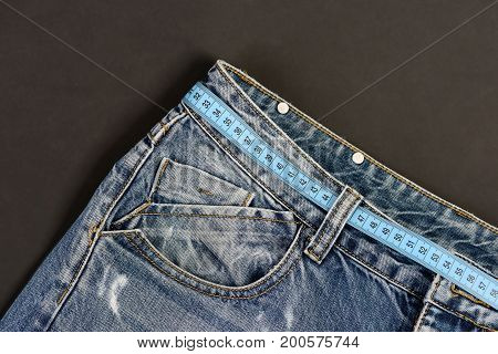 Healthy Lifestyle And Dieting Concept: Jeans Belt Loops And Pocket