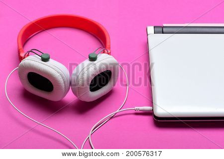 Music And Digital Equipment Concept. Earphones And Computer