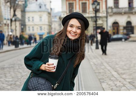 Young Laughing Woman Holding Cup Of Strip In Her Hand