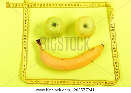 Face With Smile Made Of Ripe Fruit And Frame