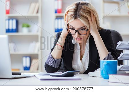 Busineswoman frustrated working in the office