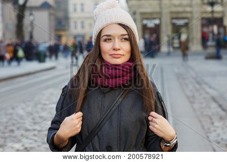 Young Woman Posing On The Street Of Old European City