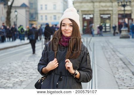 Lovely Woman Posing On The Street Of Old European City