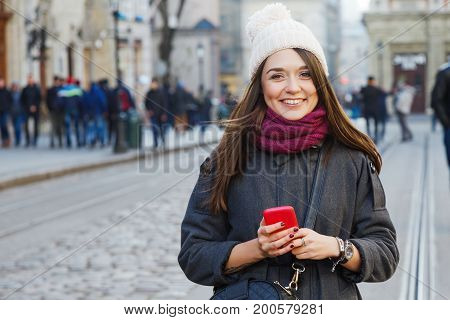 Young Smiling Woman Posing With Red Smart Phone