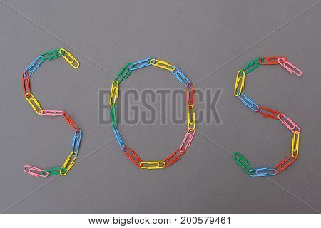 Sos Word Made Of Paper Clips Isolated