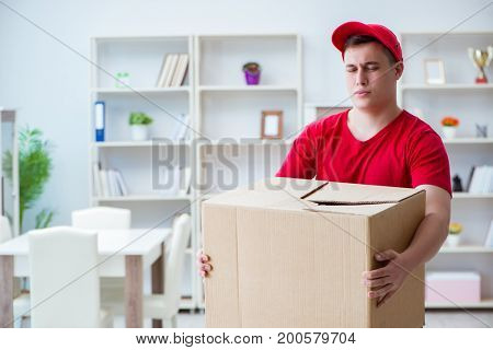 Post man delivering a parcel package