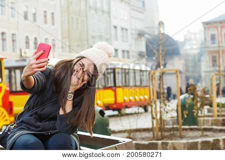 Attractive Girl, Taking Selfie On Smart Phone On The Street