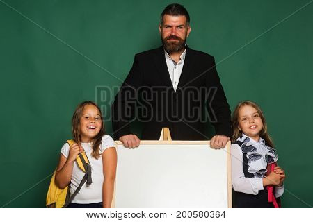 Girls In School Uniform On Green Background