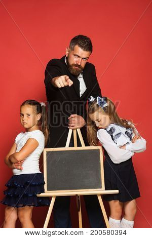 Man With Beard Pointing Ahead Stands With Children