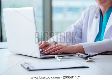 Doctor man working on the computer in lab