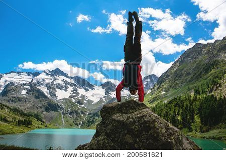 Practice Gymnastic Exercises In The Open Air In Nature.