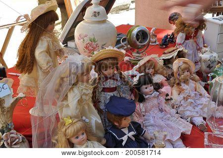 Old dolls for sale at a flea market