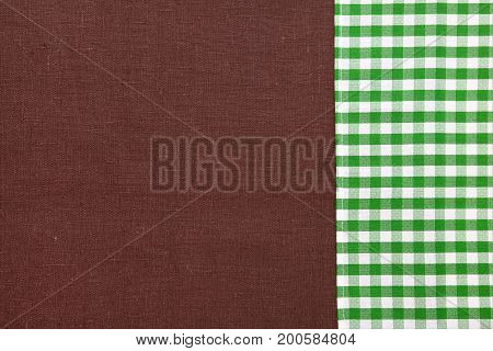 Brown linen texture for background. Green tartan linen canvas. The background image, texture. Top view and copy space. Mock up