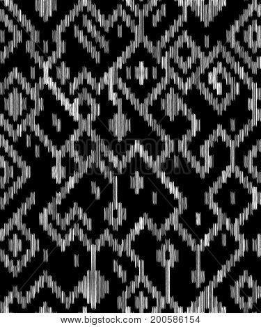Ethnic abstract geometric ikat worn out fabric pattern in black and white, vector background