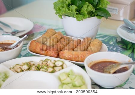 Nham nueng is vietnamese food consist of many vegetables and meatball wrapped in noodle with sauce.