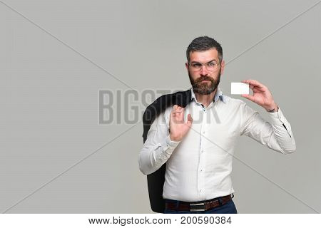 Guy With Blank Business Card. Businessman With Tricky Face