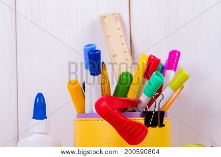 School supplies isolated on white wooden background
