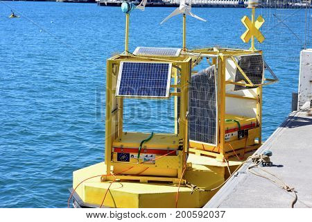 Yellow buoy with solar panel in the water